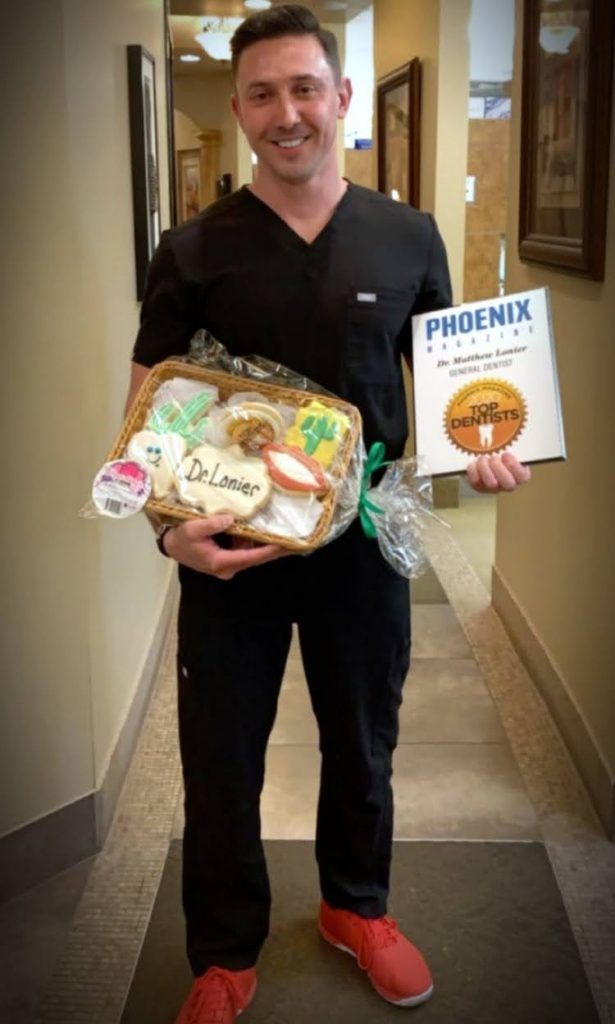 Picture of Matthew Lonier Receiving Phoenix Magazine Top Dentist Award